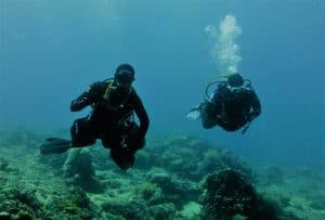 Sidemount Diver with Buddy